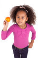 Little African Asian girl holding a tangerine  - PhotoDune Item for Sale