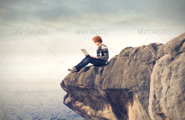 Laptop on the Cliff - Stock Photo - Images