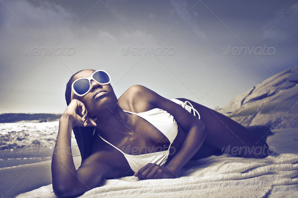 Black Woman on a Beach - Stock Photo - Images