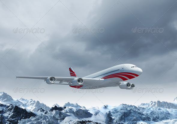 White passenger plane above the mountains - Stock Photo - Images