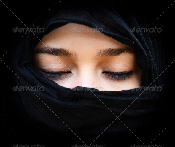 Portait of woman wearing scarf with eyes closed - Stock Photo - Images
