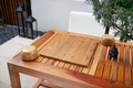 Empty Chinese go board and bowls on table in yard - PhotoDune Item for Sale
