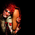 Evil Horrible Clown Holding Coffin In Darkness - PhotoDune Item for Sale