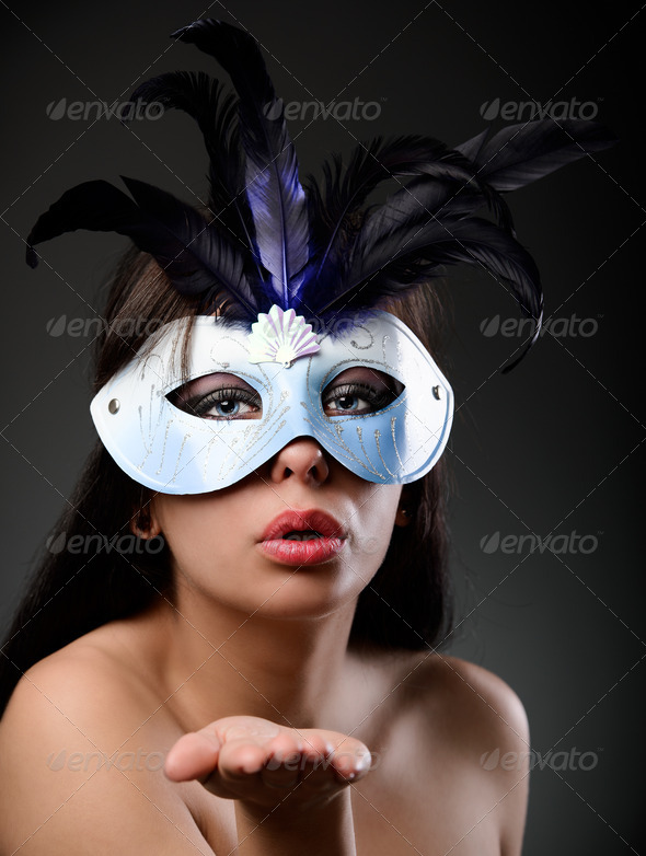 Glamour woman wearing feathered mask - Stock Photo - Images