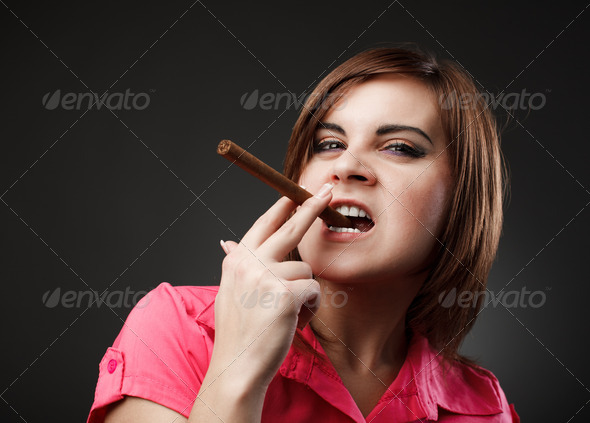 Businesswoman with cigar - Stock Photo - Images