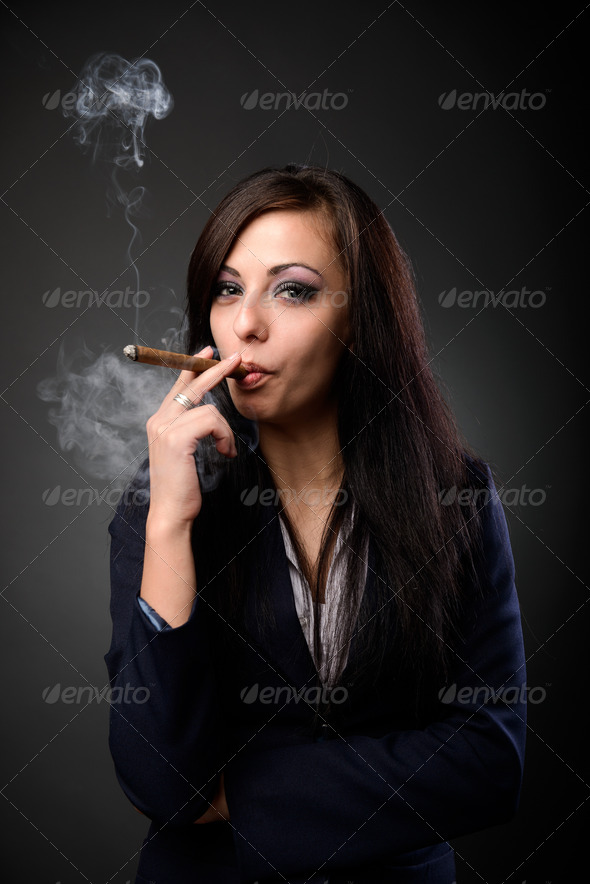 Sexy businesswoman with cigar - Stock Photo - Images