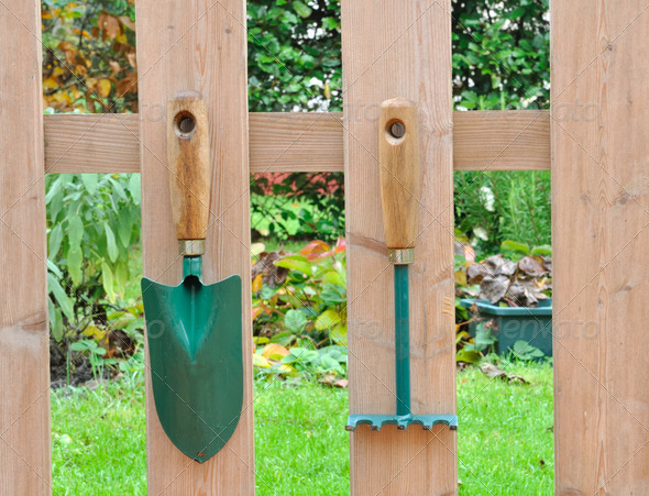 gardening tools on a fence - Stock Photo - Images