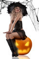 sexy witch sitting on a pumpkin - PhotoDune Item for Sale