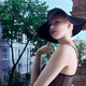 young blond fashion woman in elegant black hat  in urban backgro - PhotoDune Item for Sale