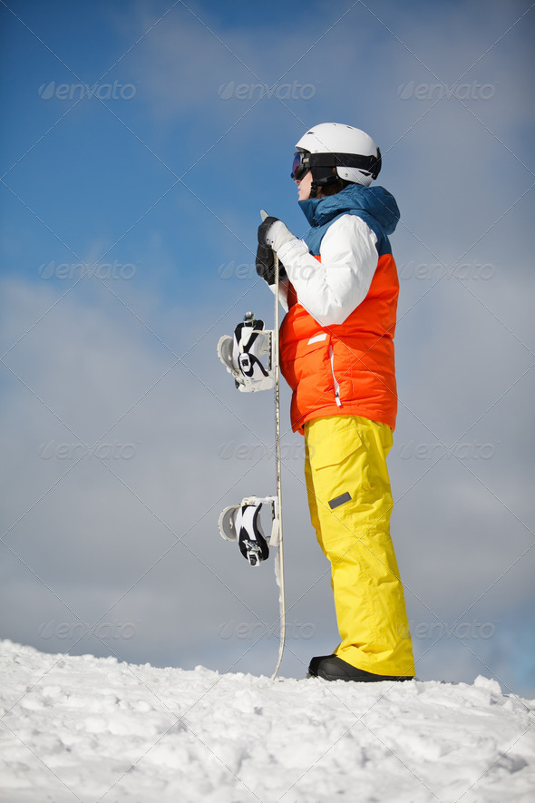 female snowboarder against sun and sky - Stock Photo - Images