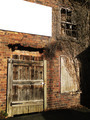Old brick wall with door broken window and place for text - PhotoDune Item for Sale