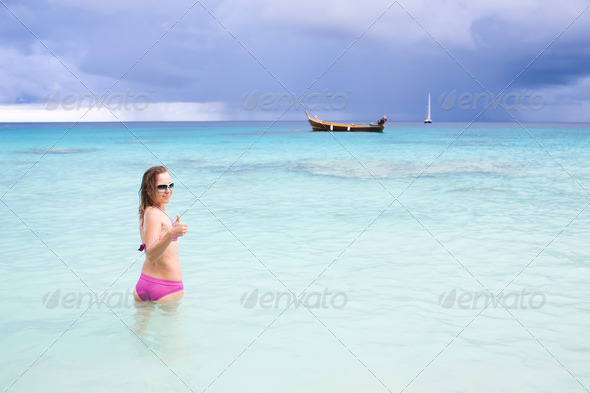 Young happy girl on the sea - Stock Photo - Images