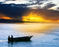 Silhouette of Fisherman on Boat at Sunset - PhotoDune Item for Sale
