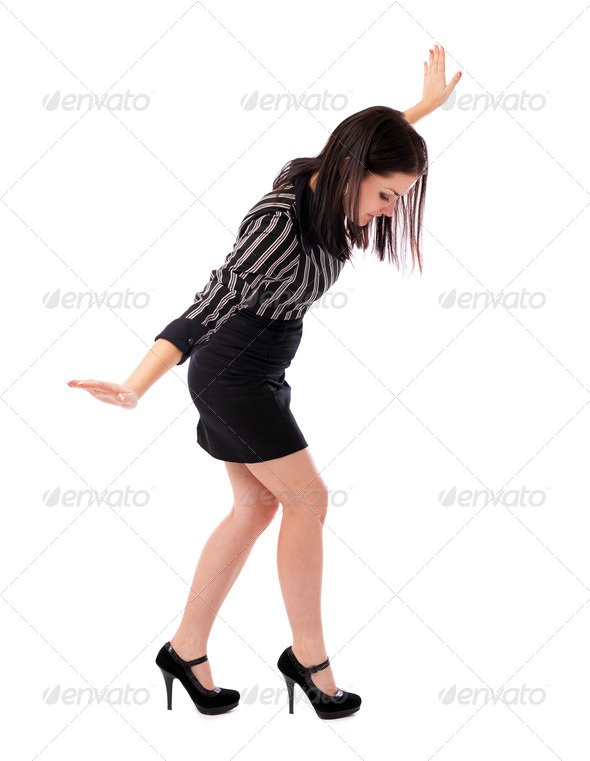 Young businesswoman walking on imaginary rope - Stock Photo - Images