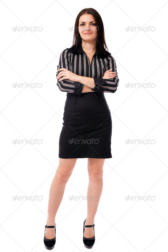 Young businesswoman standing with crossed arms - Stock Photo - Images