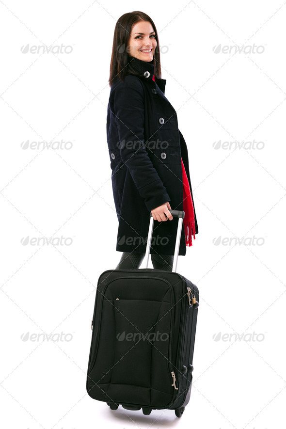 Young woman holding a luggage isolated on white background - Stock Photo - Images