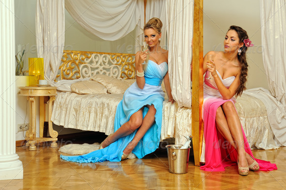 Two beautiful women celebrating event  in luxury interior. - Stock Photo - Images