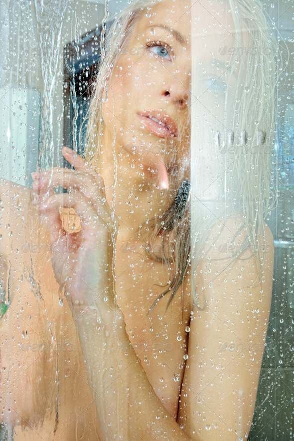 Beatiful blonde naked woman in a shower. - Stock Photo - Images