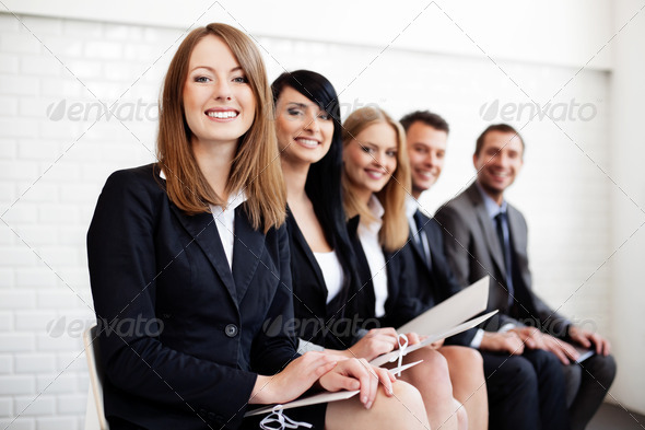 Successful businesswoman in group of people