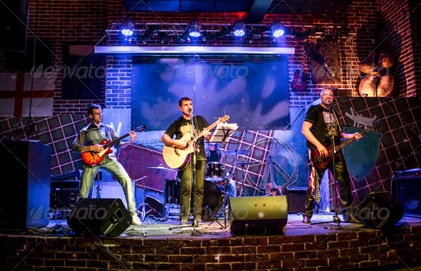 Band performs on stage - Stock Photo - Images
