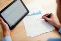 Analyzing financial data on digital tablet