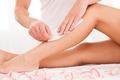 Beautician waxing a woman leg - PhotoDune Item for Sale