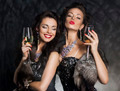 New Year's Eve of two beautiful young women with wine glasses - PhotoDune Item for Sale