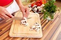 Woman cutting mushrooms - PhotoDune Item for Sale