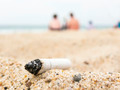 Cigarette butt on a beach - PhotoDune Item for Sale