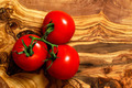 Tomatoes on an olive wood board - PhotoDune Item for Sale