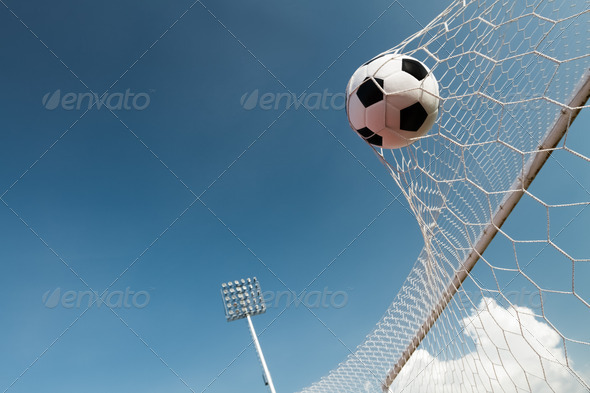 Soccer ball in goal, success concept - Stock Photo - Images