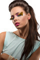 pretty brunette with feathered makeup turned of three quarters