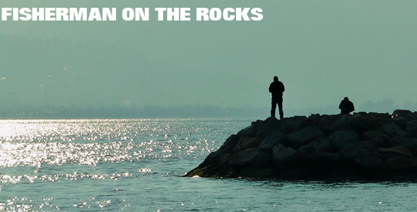 Fisherman On The Rocks