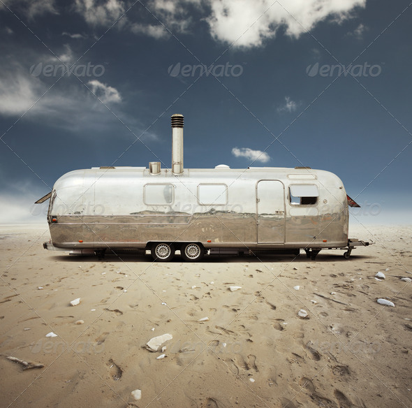 steel caravan in the desert - Stock Photo - Images