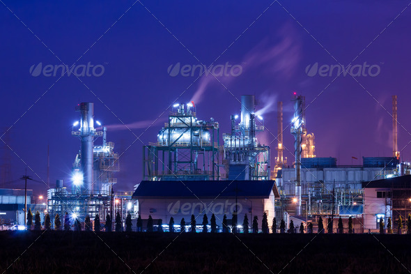 oil refinery plant and smoke at twilight morning - Stock Photo - Images