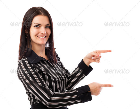 Young businesswoman pointing at copyspace - Stock Photo - Images