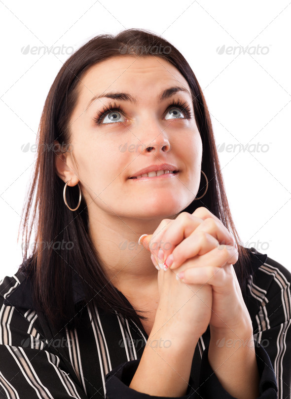 Young businesswoman praying while looking up - Stock Photo - Images