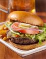 gourmet cheeseburger with mug of beer in background - PhotoDune Item for Sale