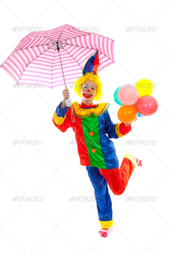 child dressed as colorful funny clown with balloons and umbrella - Stock Photo - Images