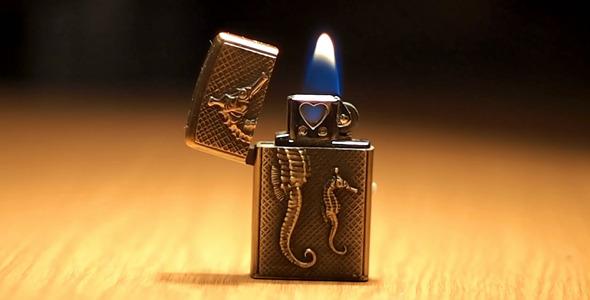 Burning Small Pocket Lighter On Table 1