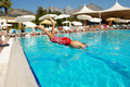 Boy jumping into swimming pool - PhotoDune Item for Sale