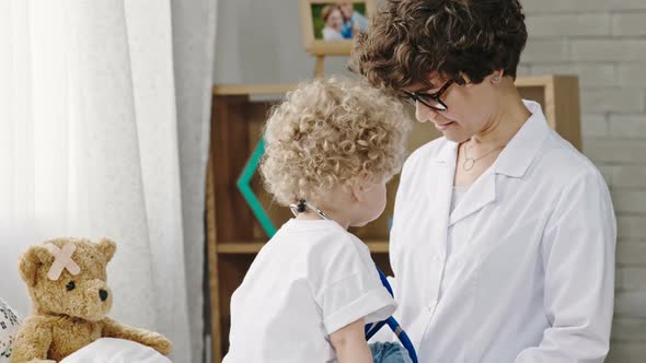 Download Toddler Pretending to be Doctor with Mother nulled download