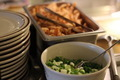 Bowl of Chopped Green Onions and Stack of Plates - PhotoDune Item for Sale