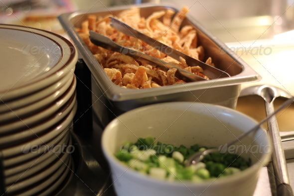 Crispy Fried Wonton Chips and Stack of Plates - Stock Photo - Images