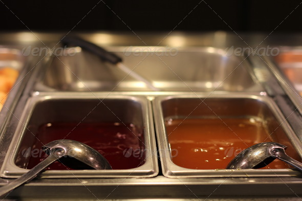 Sweet and Sour Sauce and Lemon Sauce in Bins - Stock Photo - Images