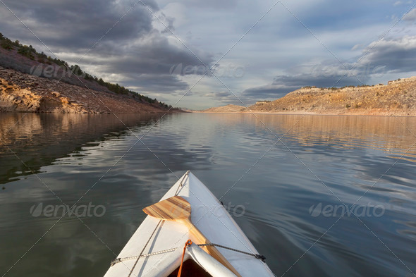 canoe on mountain lake - Stock Photo - Images