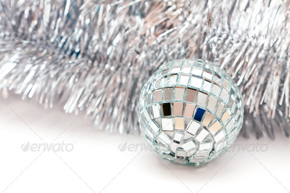 Christmas ball and a silver garland - Stock Photo - Images