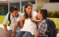 Cute Hispanic Brothers and Sister Talking Ready for School on Morning.