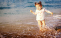 Small girl on the beach - PhotoDune Item for Sale