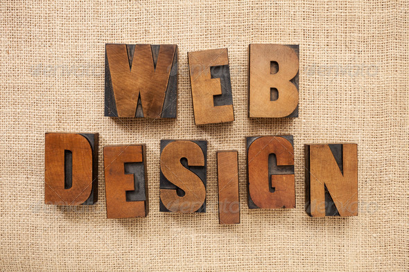 web design in wood type blocks - Stock Photo - Images